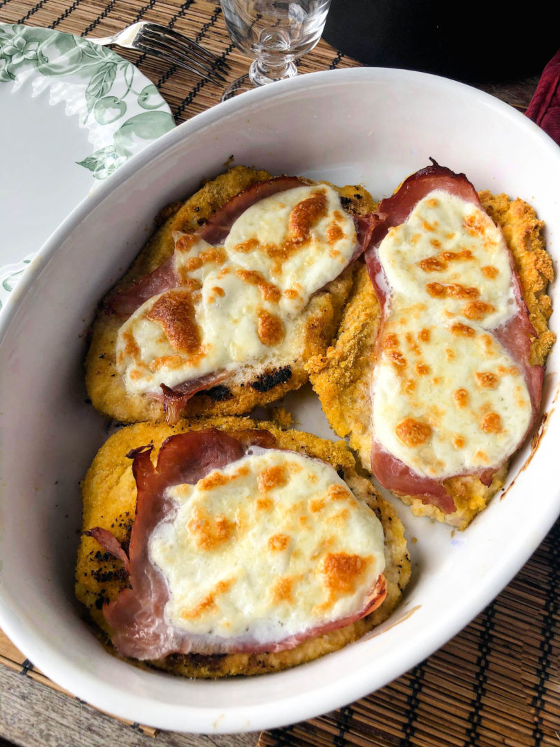 The recipe for gluten free Milanese cutlet au gratin with mozzarella cheese and ham